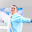 Stock Photo: Hapiness Businessman standing on the business background