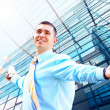 Hapiness Businessman standing on the business background — Stockfoto