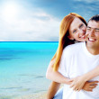 Young love couple smiling under tropical beach — Stock Photo #6354657