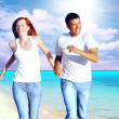 Beautiful couple on the sunny tropical beach — Stock Photo #6354670