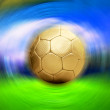 Soccer ball on the blur stadium background — Stock Photo