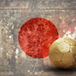 Grunge flag on the wall and ball — Stockfoto