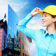 Young architect-woman wearing a protective helmet standing on th — Stockfoto