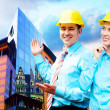 Young architects wearing a protective helmet standing on the bui — Stock Photo #6355008