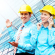 Young architects wearing a protective helmet standing on the bui — Stock Photo #6355034