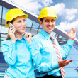 Young architects wearing a protective helmet standing on the bui — Stock Photo #6355036