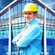 Young architect wearing a protective helmet standing on the buil — Stock Photo #6355043