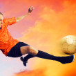 Stock Photo: Shoot of football player on sky with clouds