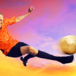 Royalty-Free Stock Photo: Shoot of football player on the sky with clouds