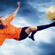 Shoot of football player on the sky with clouds — Foto Stock