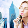 Happiness businesswoman calling by phone on the business archite — Foto de Stock