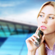 Happiness businesswoman calling by phone on the business archite — Lizenzfreies Foto
