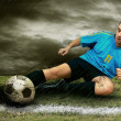 Foto Stock: Soccer players on field