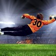 Football goalman on the stadium field — Stock Photo