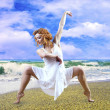 Woman dancer posing on the beach — Stock Photo #6355399