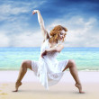 Stock Photo: Woman dancer posing on the beach