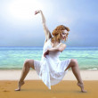 Woman dancer posing on the beach — Stock Photo #6355403