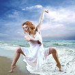 Woman dancer posing on the beach — Stock Photo #6355408