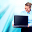 Happiness businesswoman with laptop on blur business architectur — Zdjęcie stockowe