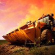 Yellow tractor on golden surise sky — Stock Photo #6355537