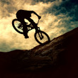 Silhouette of a man on muontain-bike, sunset — Stock Photo #6355602