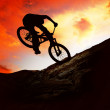 Silhouette of a man on muontain-bike, sunset — Stock Photo #6355609