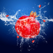 Water drops around red fruit on blue background - Stock Photo