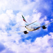 Stock Photo: airplane at fly on the sky with clouds