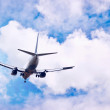 Airplane on the blue sky — Stock Photo