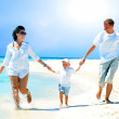 View of happy young family having fun on the beach — Stock Photo #6356370