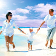 View of happy young family having fun on the beach — Stock Photo #6356372