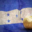 Grunge flag on the wall and ball — Stock Photo #6356396