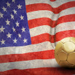 Grunge flag on the wall and ball - Stock Photo