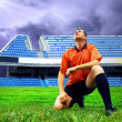 Happiness football player after goal on the field of stadium und — Stok fotoğraf