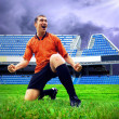Happiness football player after goal on the field of stadium und — 图库照片