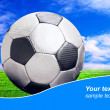 Ball on the field of stadium with blue sky and sample text - Stock Photo