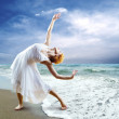 Woman dancer posing on the beach — Stock Photo #6356710