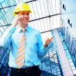 Young architect wearing a protective helmet standing on the buil — Foto Stock