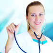 Smiling medical doctor with stethoscope on the hospitals backgro — Stock Photo #6356915
