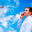 Happy businessmen on sky with clouds background — Stock Photo