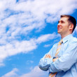 Happy businessmen on sky with clouds background — Stockfoto
