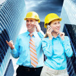 Young architects wearing a protective helmet standing on the bui — Stock Photo #6357160