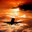 Airplane on sunset sky - Foto de Stock