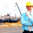 Young architect wearing a protective helmet standing on the buil — Stock Photo #6357342