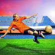 Happiness football player after goal on the field of stadium und — Stockfoto