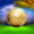 Soccer ball on the blur stadium background - Stock Photo
