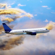 Airplane on blue sky — Foto Stock