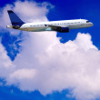 Airplane on blue sky - Lizenzfreies Foto