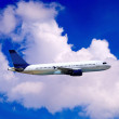 Airplane on blue sky - Foto de Stock