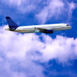 Airplane on blue sky — Stockfoto